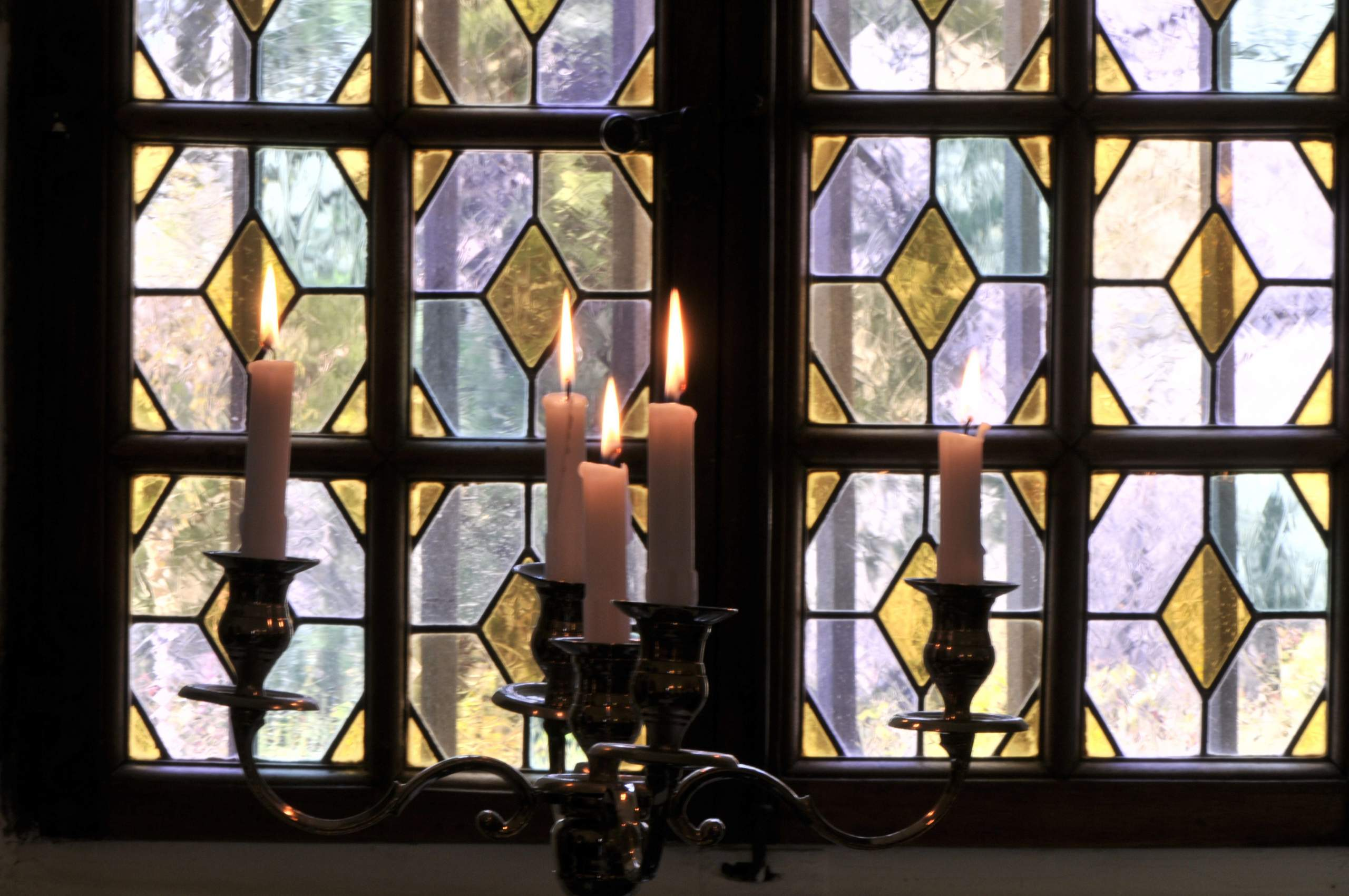 Stained-glass windows close-up and candelabrum
